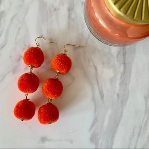 Charming Charlie Orange Pom Pom Earrings